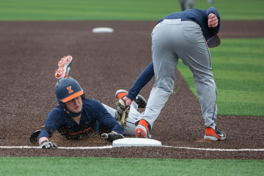 An+Illinois+baseball+player+slides+into+third+base+during+practice+on+Feb.+26.+The+Illinois+baseball+team+won+one+of+four+games+against+Ohio+State+this+past+weekend.