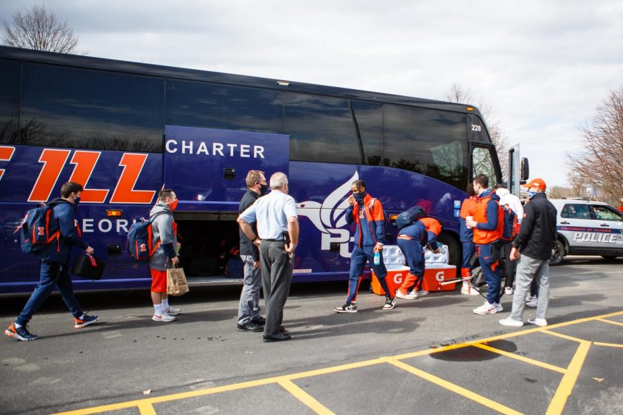 The Illinois mens basketball team pack the teams coach bus before leaving for Indianapolis on March 11. The Illini are packing and preparing to be gone for a month and make a deep NCAA tournament run.