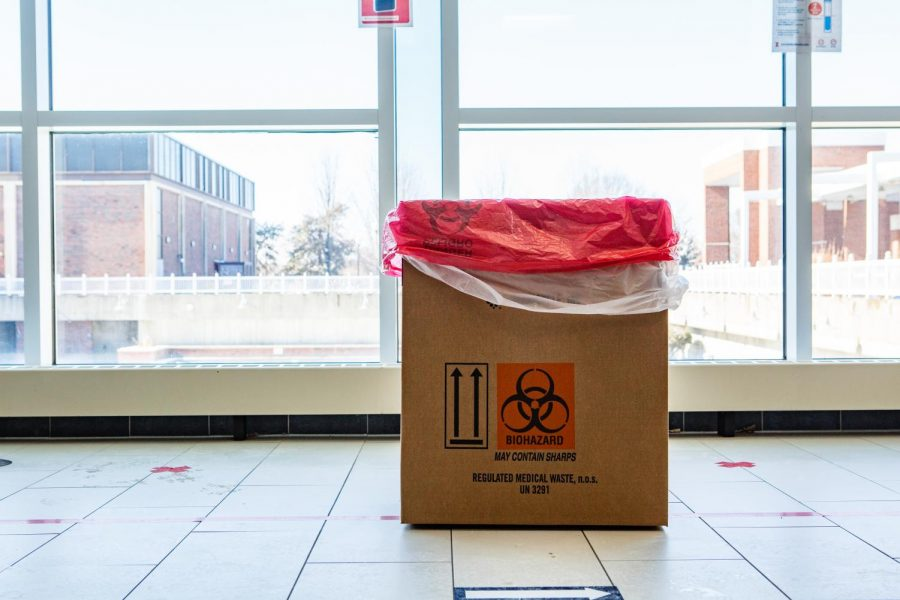 A biohazard trash stands in the middle of the ARC for students to dispose of COVID-19 testing materials on Feb. 1. Illinois graduate students are concerned about a lack of information from the University about COVID-19 disciplinary actions.