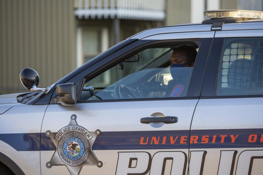 A University police officer pulls away from a scene after responding to a call on Oct. 8. The University of Illinois Police Department plans on hiring a social worker to assist with mental health concerns on the job.