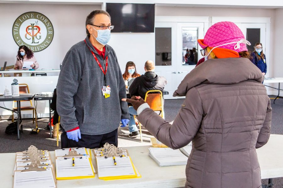 A+COVID-19+vaccination+worker+checks+in+a+patient+at+the+Church+of+the+Living+God+on+Feb.+20.+Two+University+students+are+organizing+a+pop-up+vaccination+clinic+to+serve+impoverished+community+members.+