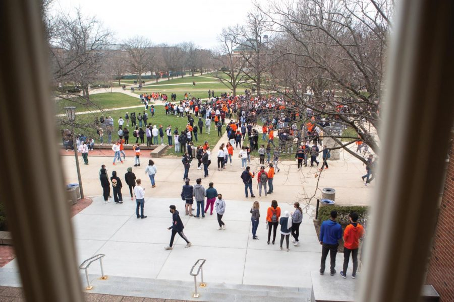 A crowd of students rushed the Main Quad after the Illinois men's basketball team was named Big Ten champions on March 14. University students have been socializing more now that Champaign-Urbana has been lifting restrictions.
