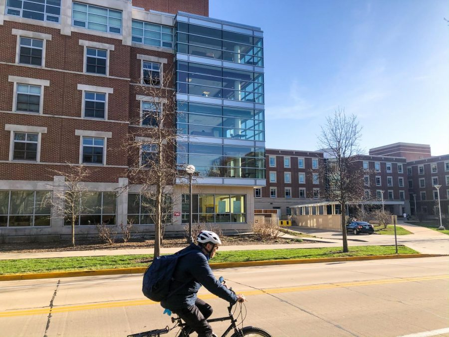 A+biker+rides+by+Nugent+Hall+on+Gregory+Drive+on+Monday+afternoon.+Students+and+resident+advisers+have+had+to+adapt+to+dorm+life+during+an+academic+year+like+no+other+due+to+COVID-19.+