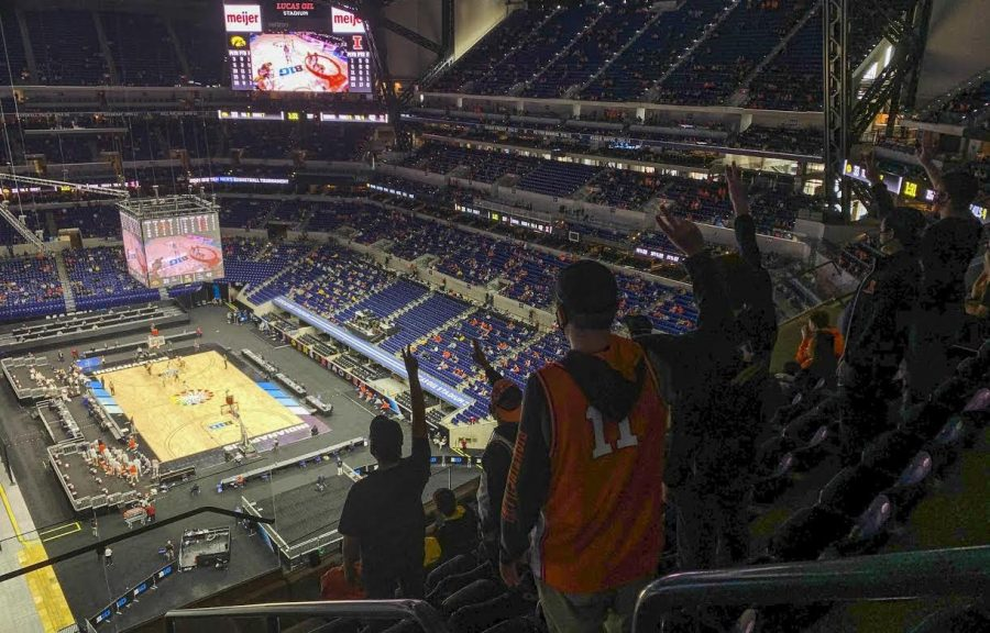 Fans at Lucas Oil Stadium in Indianapolis cheer on the Fighting Illini basketball team on Saturday. The team has a chance to make University history during the NCAA Big Ten Tournament.