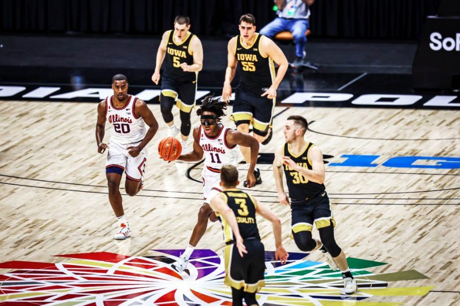 Ayo Dosunmu dribbles down the court in the Big Ten Tournament matchup against Iowa on Saturday at Lucas Oil Stadium. The Fighting Illini have to focus on five aspects to thrive in the NCAA tournament.