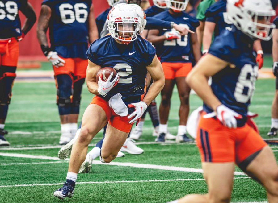 Junior Chase Brown completes a drill during the University of Illinois's first football practice on Tuesday. New head coach Bret Bielema has been making changes to the Illini's offense and defense after taking over for former head coach Lovie Smith in December.