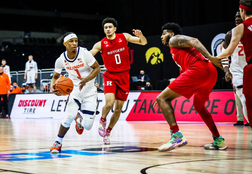 Trent Frazier runs past his defensive opponents during the Big Ten Tournament matchup against Rutgers on Friday at Lucas Oil Stadium. Frazier has grown to play both sides of the ball which has helped the Fighting Illini become a highly successful Big Ten team.