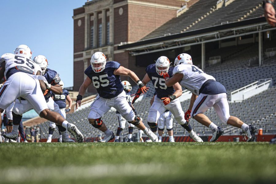 The Illinois football team's offensive line performs drills during practice Sunday. Several offensive line veterans are returning for another year at Illinois.