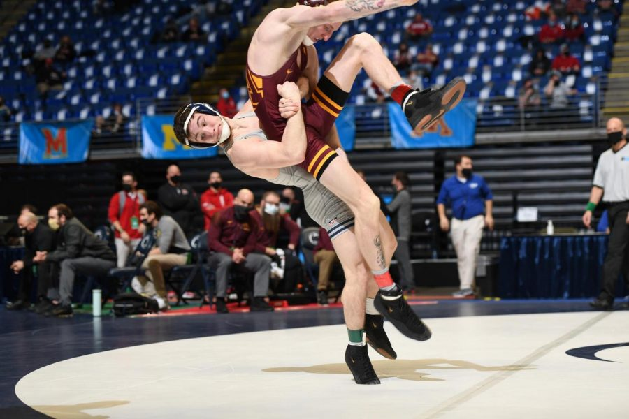 Lucas Byrd throws his opponent to the ground during competition. Byrd recently placed fifth at the NCAA Championships.
