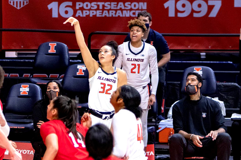 Aaliyah McQueen (21) cheers on Aaliyah Nye (32) as she shoots a 3-pointer at State Farm Center on Jan. 25 against Nebraska. Nye and McQueen share a first name, are from Michigan and have a great bond tied together by basketball.