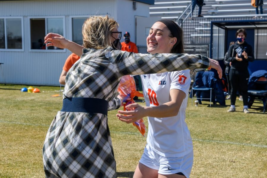 Senior+Hope+Breslin+leans+in+for+a+hug+with+head+coach+Janet+Rayfield+during+Senior+Day+on+Sunday.+The+Illini+women%E2%80%99s+soccer+seniors+reflect+on+their+growth+and+experience+while+playing+for+the+team.%0A