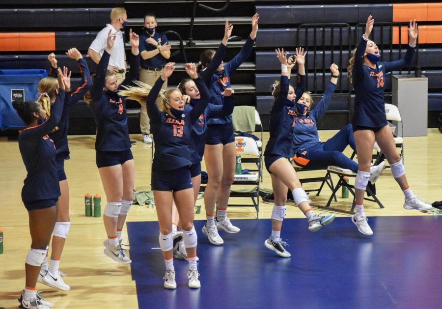 The+Illinois+volleyball+team+cheers+by+their+bench+in+a+game+against+Indiana+Saturday.+The+bench+was+full+of+energy+this+weekend+with+family+members+finally+allowed+in+the+stands+at+Huff+Hall.%0A