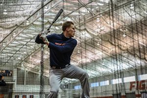 Cam McDonald takes batting practice during Illinois' team practice on Jan. 29.
