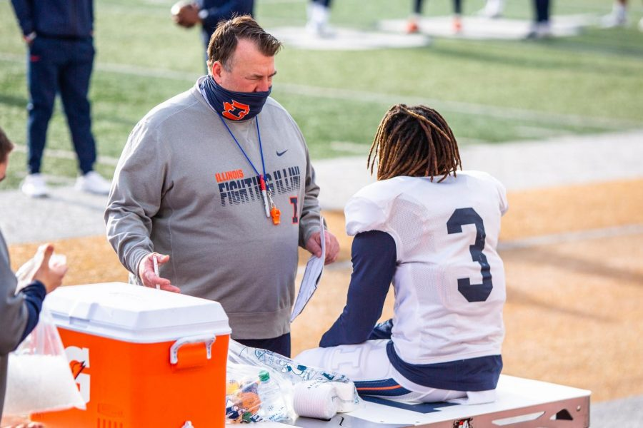 Defensive back Marquez Beason talks to new head coach Bret Bielema on the sidelines during practice Tuesday morning. Five Illini players are looking to have a breakout spring campaign, including Beason.