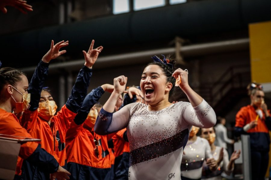 Senior Kylie Noonan celebrates during the Big Ten Women's Gymnastics Championships on Saturday. The Fighting Illini tied with Iowa for third place and finished with 196.625 points.