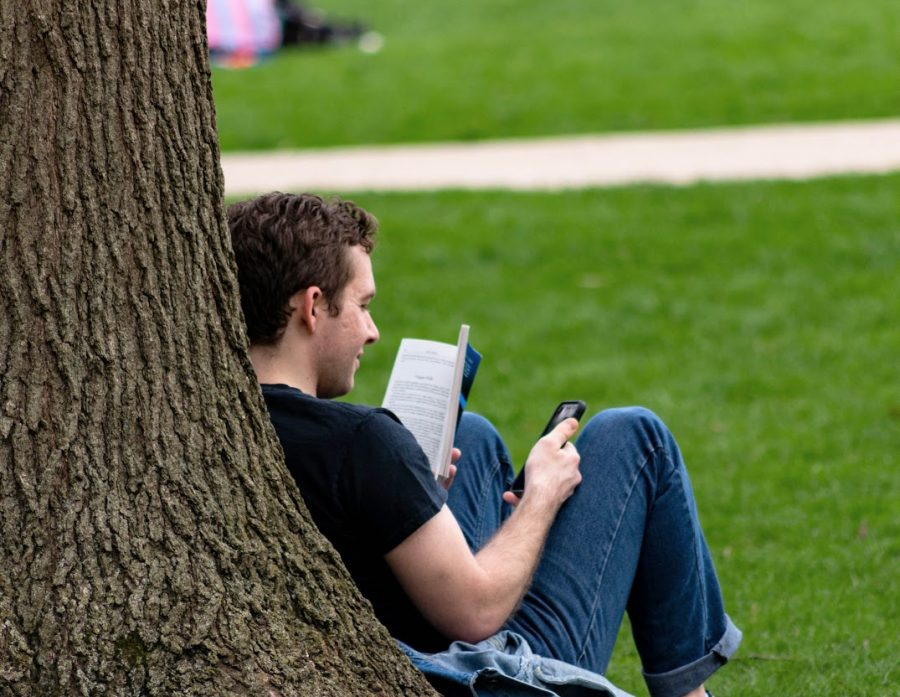 An Illinois student relaxes on the Main Quad on April 3. Columnist Noah advocates for taking relaxation time for yourself.