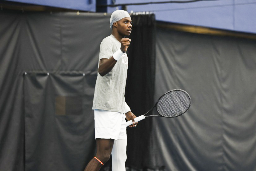 Kweisi Kenyatte celebrates after winning a point against Penn State at Atkins Tennis Center on Feb. 19. The Fighting Illini rallied together after a few close matches and beat Northwestern on Sunday afternoon.