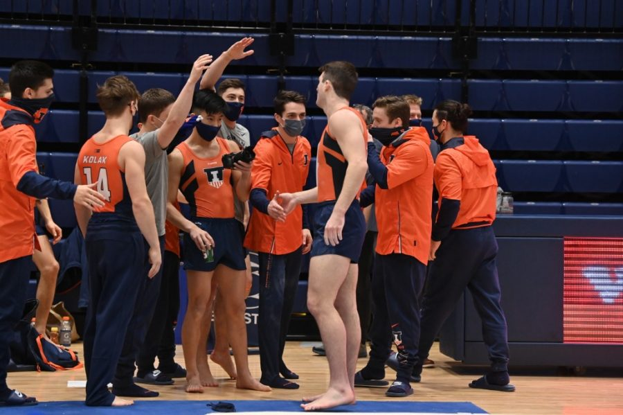 The+Illini+men%E2%80%99s+gymnastics+team+joins+a+huddle+during+a+meet+against+Penn+State+on+Jan.+31.+The+Illini+recently+competed+against%2C+and+assumed+a+narrow+win+over%2C+the+Minnesota+Golden+Gophers+on+Monday.
