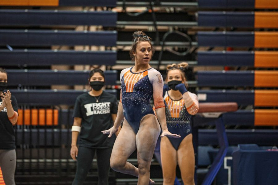 Senior Nicole Biondi performs her floor routine during the meet against Michigan on Feb. 21. The Illinois women's gymnastics team will compete against Minnesota tonight.