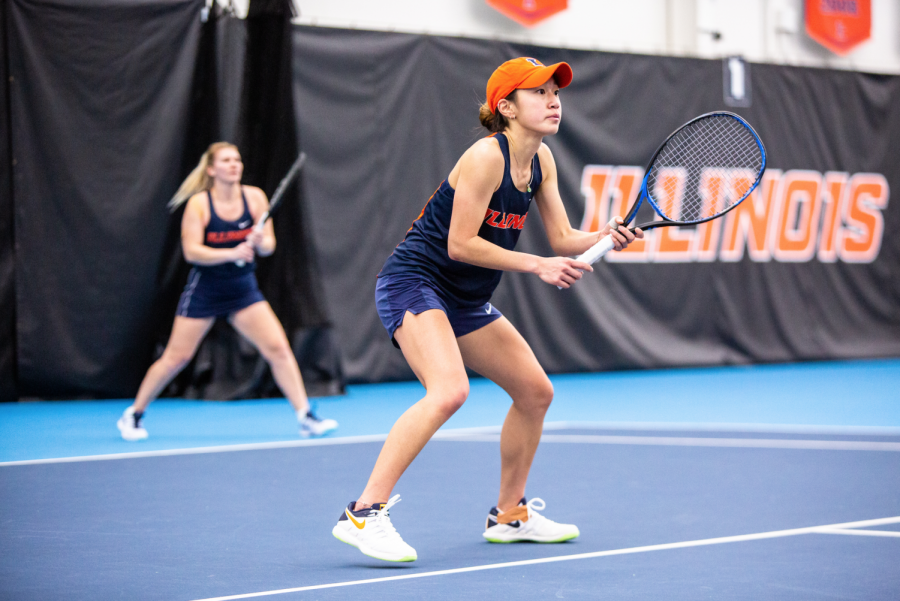 Senior Emilee Duong waits for Wisconsin to return the ball at Atkins Tennis Center on Feb. 26. The Fighting Illini women's tennis team narrowly lost to Wisconsin, but pushed through and won against Minnesota this weekend.