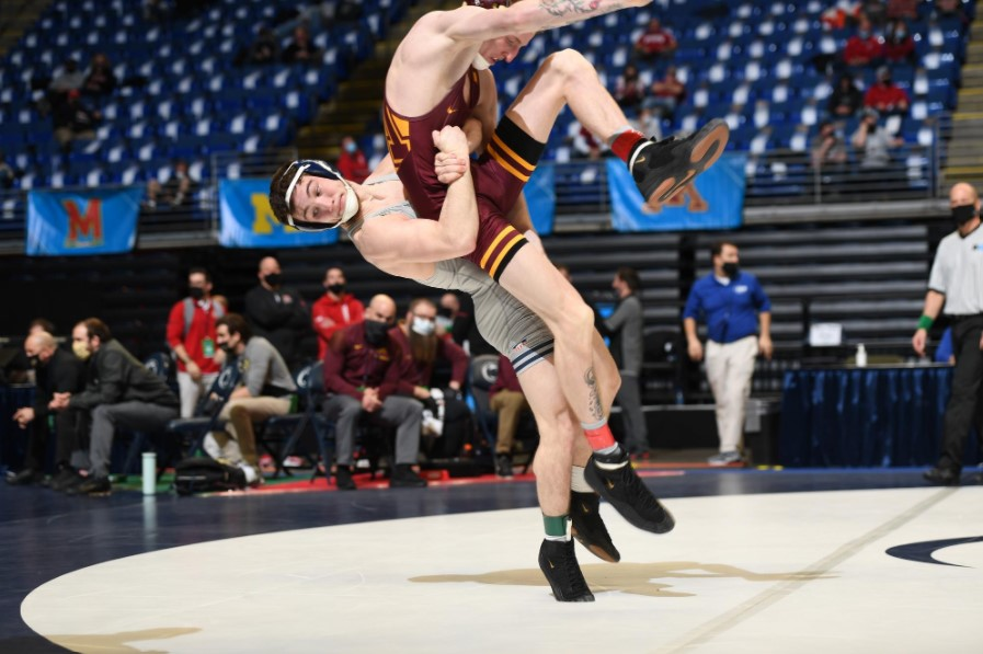Redshirt+freshman+Lucas+Byrd+lifts+his+opponent+off+the+ground+while+competing+at+the+Big+Ten+Championships+on+Sunday.+Byrd+placed+3rd+in+the+133-pounds+weight+class.