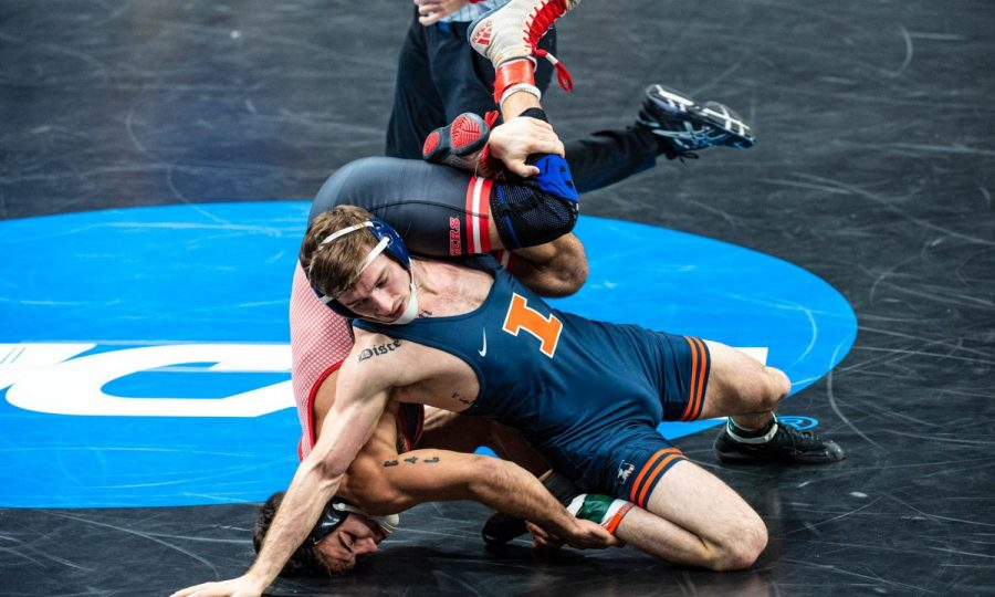 Senior Dylan Duncan wrestles against a man from Rutgers at the 2021 NCAA DI Wrestling Championships in St. Louis, Missouri this weekend. Dylan Ducan and Lucas Byrd tied for fifth after competing with some of the best wrestlers in the nation.