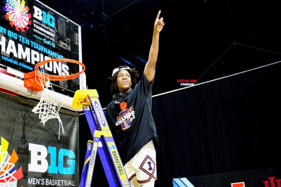Junior Ayo Dosunmu points to the crowd while cutting down the net after the Big Ten Tournament win on March 14 at Lucas Oil Stadium. Dosunmu won the Bob Cousy Award Saturday afternoon.