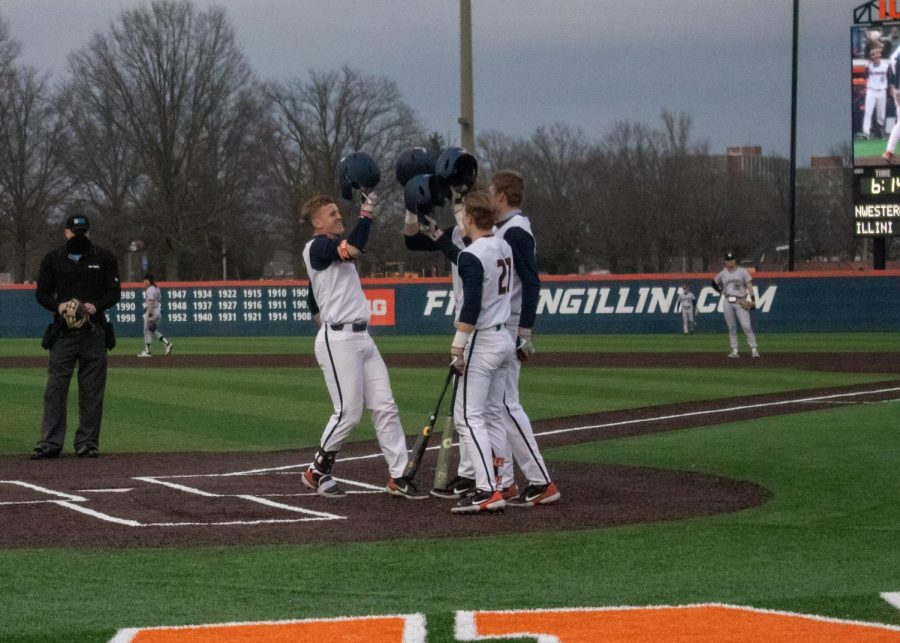 Jackson+Raper+celebrates+with+teammates+at+home+plate+after+hitting+a+home+run+against+Northwestern+Friday+at+Illinois+Field.+The+Illini+beat+the+Wildcats+12-8+Friday+but+ultimately+lost+the+series+2-1.