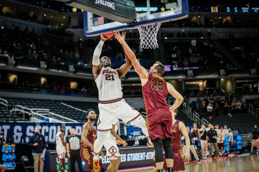 Sophomore Kofi Cockburn goes up for a contested layup against  Cameron Krutwig during the game against Loyola Chicago Sunday at Bankers Life Fieldhouse in Indianapolis, Indiana. The Illini fell to the 8-seeded Ramblers 71-58, ending their season.