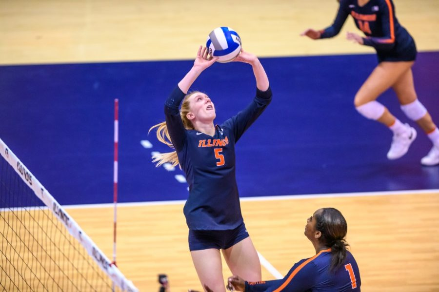 Diana Brown sets the volleyball for a teammate in the game against Nebraska on March 5. The Fighting Illini hope to break their losing streak this weekend as they are scheduled to play against 4-10 Maryland at Huff Hall.