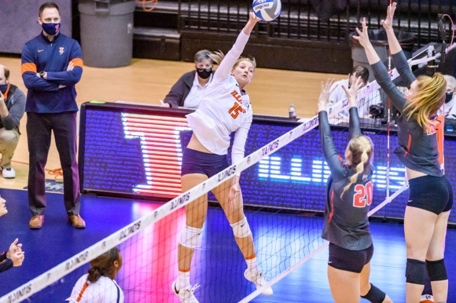 Senior+Megan+Cooney+spikes+the+ball+during+the+game+against+Ohio+State+on+Feb.+19.+The+women%27s+volleyball+team+lost+two+matches+to+Nebraska+this+weekend.