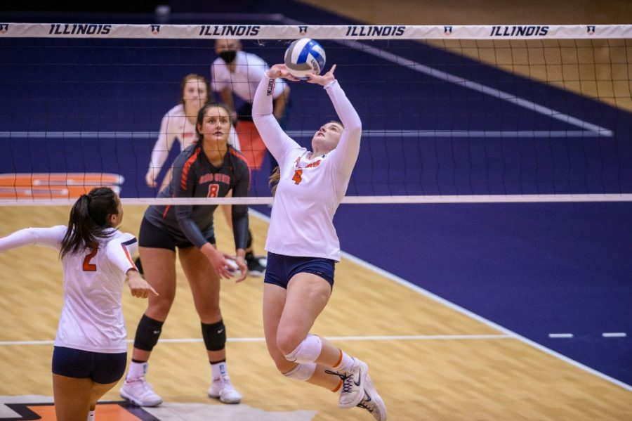 Senior Kylie Bruder sets the ball for Rylee Hinton during a game against Ohio State on Feb. 19. The Fighting Illini women's volleyball team will host their last home meet against Indiana while honoring their seniors this weekend.