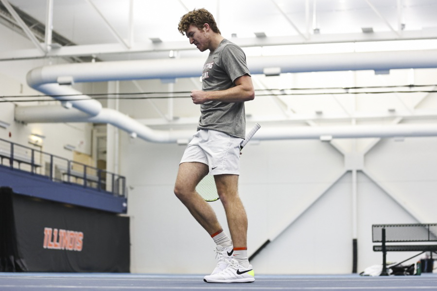 Junior Alex Brown celebrates after a play against Penn State on Feb. 19. Multiple players on the men's tennis team received honorable rankings from the Intercollegiate Tennis Association ahead of their matches against Michigan and Michigan State this weekend.