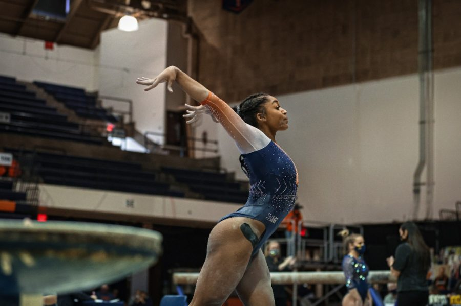 Junior Shaylah Scott competes during the meet against Michigan on Feb. 21. The Illini will face Iowa today.