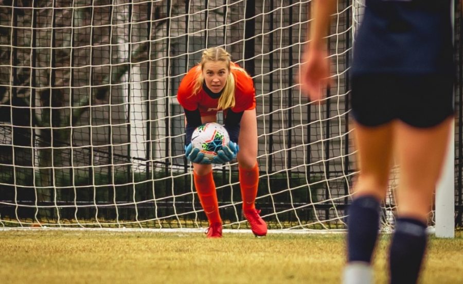 Illini women's soccer goalie Sami Sample saves a ball from going into the net during the game against Penn State on Feb. 28. Samples just received the Big Ten goalkeeper of the week award.