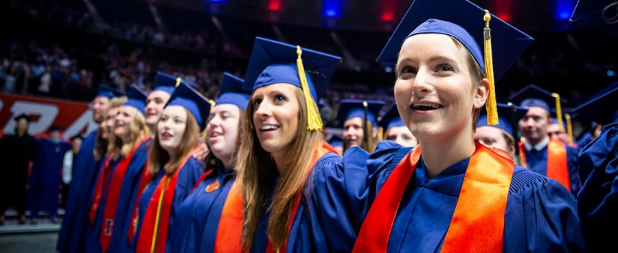 Illinois graduates participate in commencement at State Farm Center in May of a previous year. This year, commencement will be held virtually.