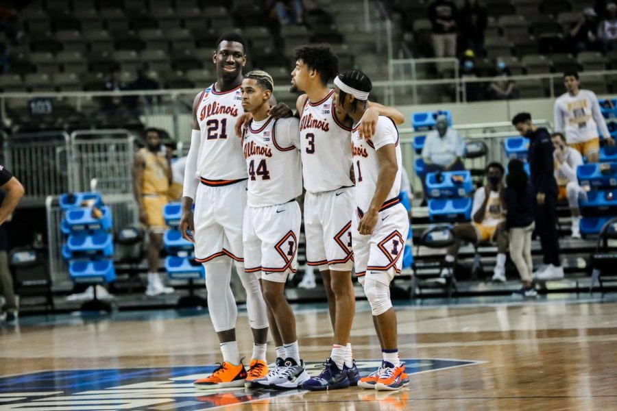 Kofi Cockburn, Adam Miller, Jacob Grandison and Trent Frazier (left to right) stand together neat mid-court during the game against Drexel on March 19. A dominant display from Frazier saw the Illini advance to the Round of 32 of the NCAA tournament.