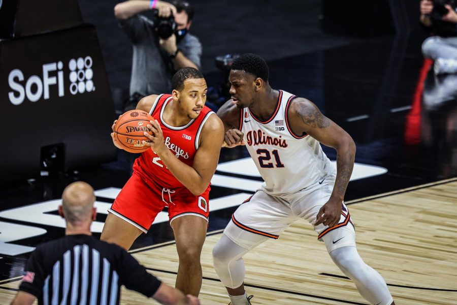 Sophomore Kofi Cockburn defends Ohio State freshman Zed Key during the Big Ten Tournament title game on March 14 at Lucas Oil Stadium. The Illini won 91-88 in overtime, winning their first Big Ten Tournament title since 2005.