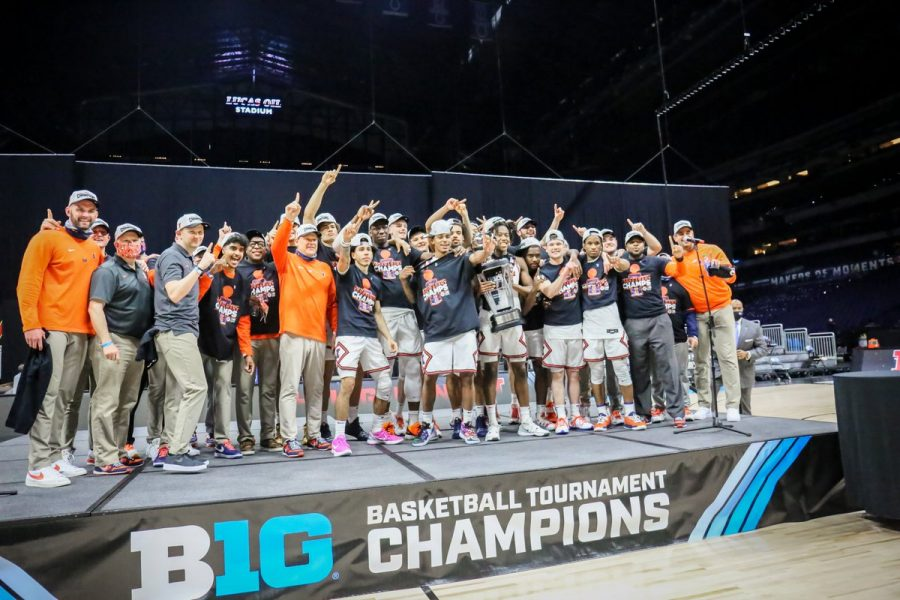 The Illini pose with the Big Ten Tournament trophy after beating Ohio State 91-88 in the title game on March 14 at Lucas Oil Stadium. Andre Curbelo, Giorgi Bezhanishvili and Da'Monte Williams stepped up for the Illini, helping them snap a 16-year title drought.