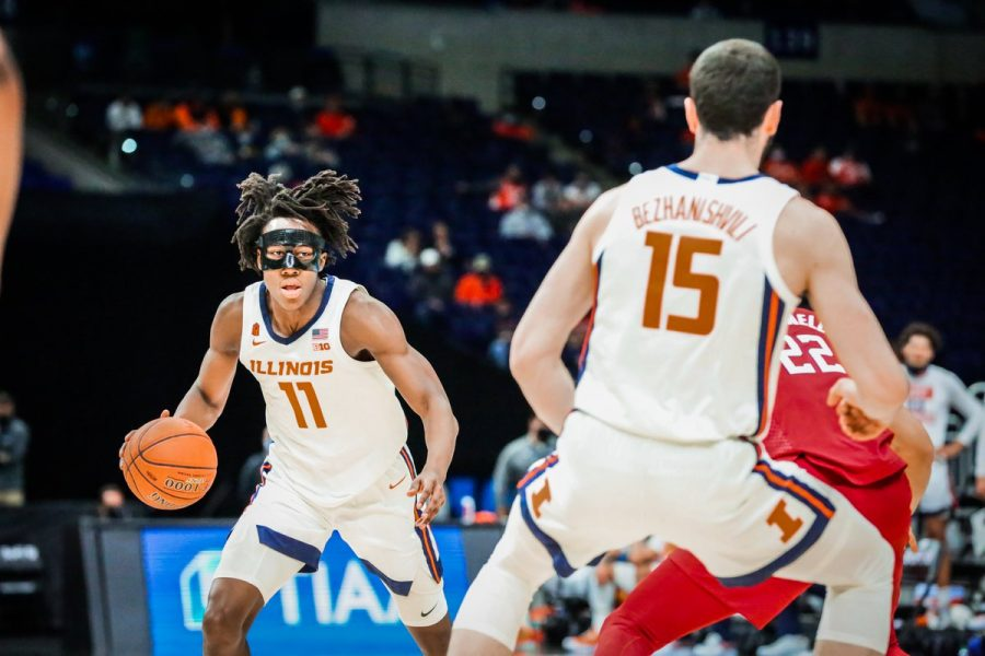 Junior Ayo Dosunmu dribbles the ball during the game against Rutgers on March 12. Dosunmu's 23 points, five rebounds and six assists were huge in the Illini's 90-68 win over the Scarlet Knights.