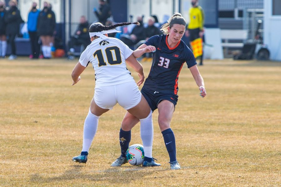 Ashley Cathro fights over the ball in order to retain possession over Iowa on Feb. 26. The team will continue to fight for a spot in the Big Ten Championship.