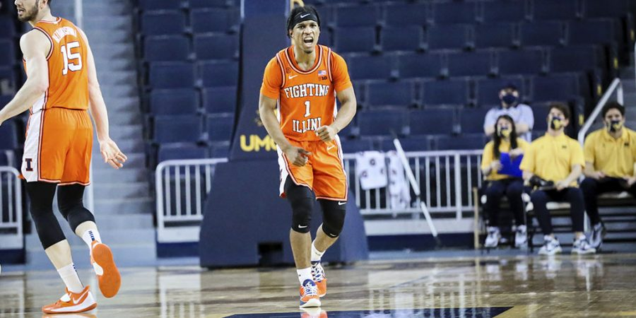 Trent Frazier celebrates in the game against Michigan on Wednesday in Ann Arbor, Michigan. The Illini beat the Wolverines 76-53.