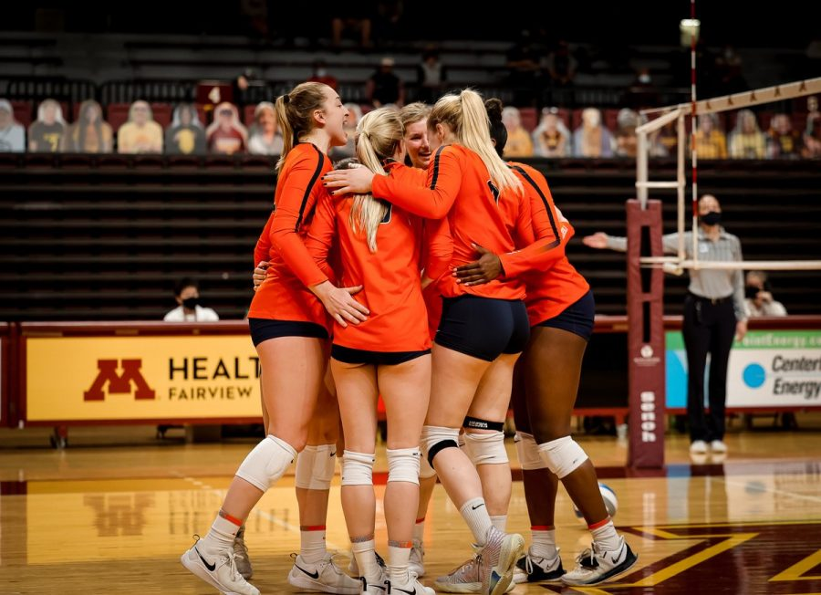 The+Illinois+volleyball+team+huddles+on+the+court+during+a+match+against+Minnesota+on+March+13.+The+Illini+lost+to+the+Golden+Gophers+in+both+matches+this+weekend.+