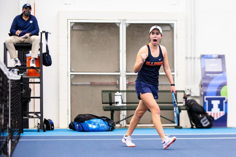 Freshman Kate Duong celebrates after winning a point in her doubles match against Wisconsin Feb. 26 at Atkins Tennis Center. The Illinois women's tennis team will face Michigan State Friday in Urbana, Illinois, before traveling to West Lafayette, Indiana, for its match against Purdue Sunday.