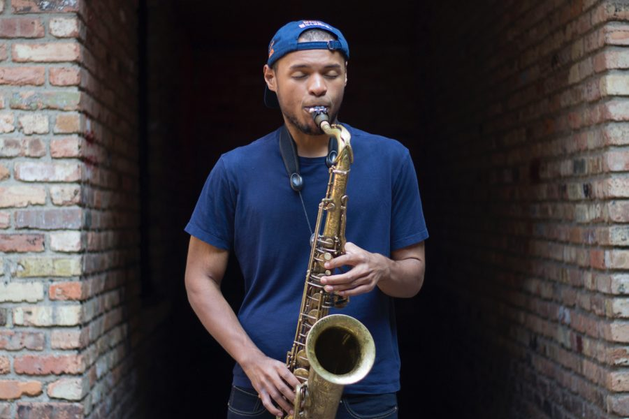 Senior Kevin King plays his saxophone in front of the Canopy Club on September 23, 2019. King is the older representation of the Universities bustling musician scene, some of whom recently played outside of Ikenberry Commons this week.