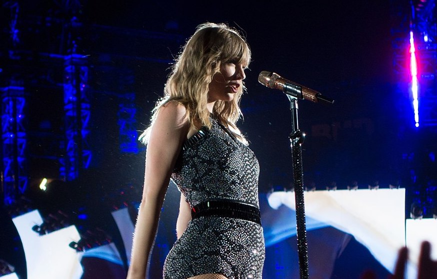 Taylor Swift performs on stage during her Reputation tour in May 2018. Columnist Noah Nelson exclaims that Swift is a genius for implementing hidden easter eggs throughout her song lyrics and music videos.