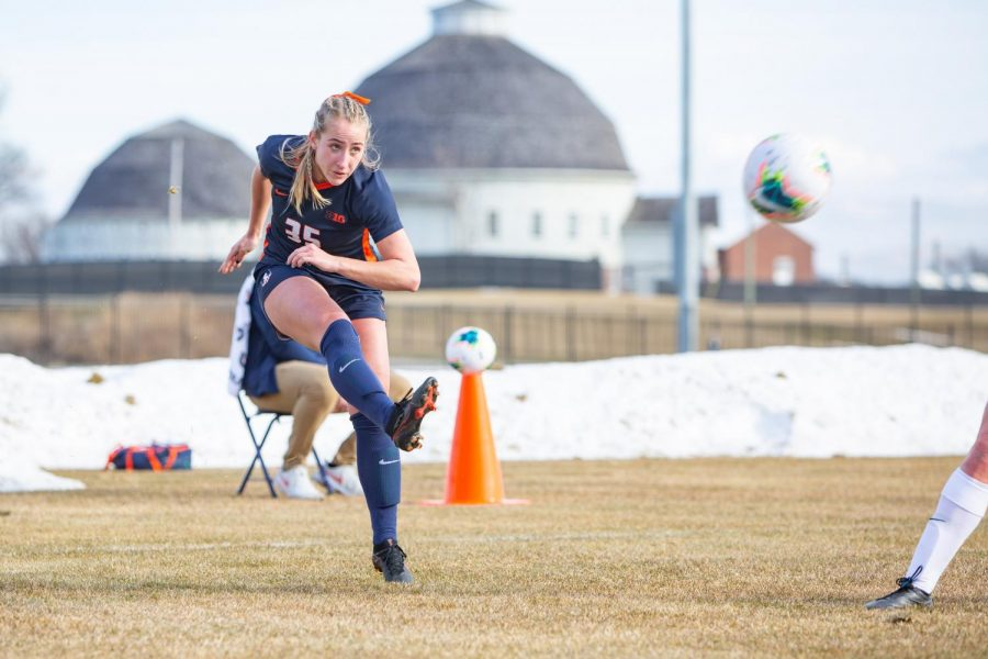 Junior Lauren Stibich kicks the ball during a game against Iowa on Feb. 25. The Illini soccer team is set to finish off their regular season at Northwestern today.