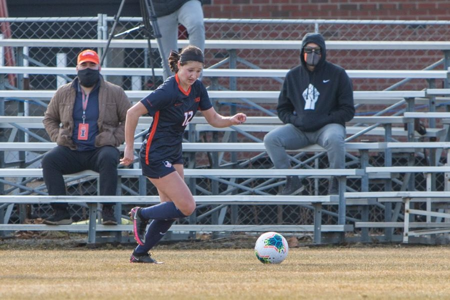 Sophomore Kendra Pasquele runs to the soccer ball during their game on Feb. 26 against Iowa. Kendra Pasquale is only one of four who earned honors for the program.