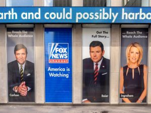 An advertisement of the Fox News anchors is pasted on the side of a building in New York City on June 29, 2019. Columnist Dennis Austin argues that America and the citizens who live there are becoming increasingly selfish.