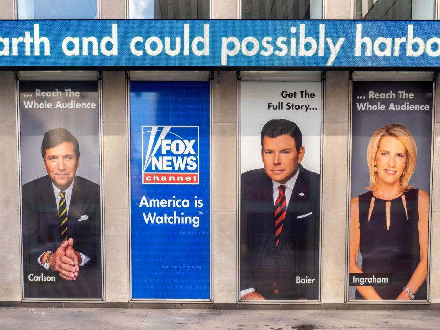 An+advertisement+of+the+Fox+News+anchors+is+pasted+on+the+side+of+a+building+in+New+York+City+on+June+29%2C+2019.+Columnist+Dennis+Austin+argues+that+America+and+the+citizens+who+live+there+are+becoming+increasingly+selfish.